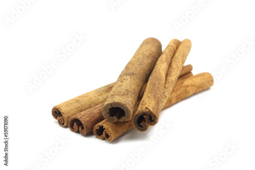 spicy cinnamon sticks on white background - Buy this stock