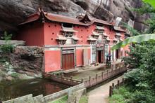 Temple Building Leaning Against A Vertical Rock In Qiyun Taoist