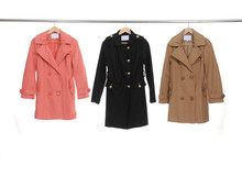 Three Female Coat Clothes On A Hanger