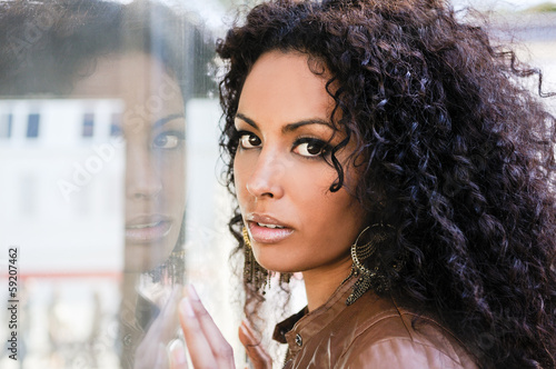 Fényképezés  Young black woman, afro hairstyle, in urban background