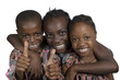 canvas print picture Drei afrikanische Kinder halten Daumen hoch