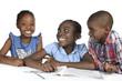 canvas print picture Drei afrikanische Kinder beim Lernen