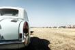 Classic car in a field