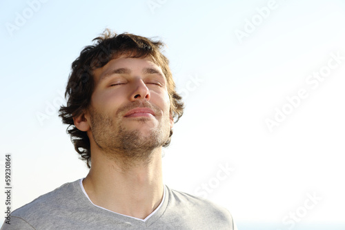 Fotografie, Obraz  Attractive man breathing outdoor