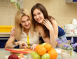 daughter teenager with her mother peel and cut vegetables togeth