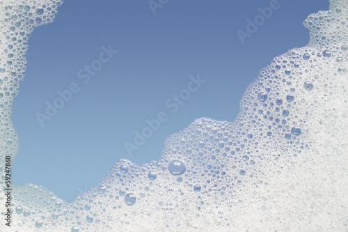 Border of bubble foam soap in blue water. Canvas-taulu