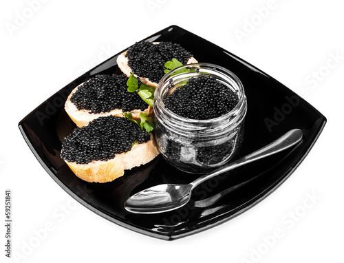 Sandwiches with black caviar on dark plate