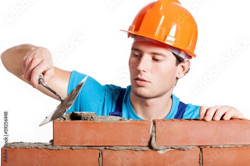 Fotografia, Obraz  Construction mason installing red brick
