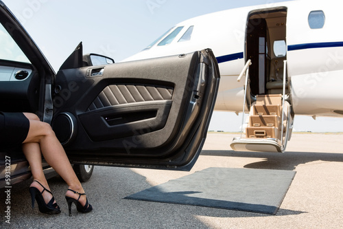 Stampa su Tela Wealthy Woman Stepping Out Of Car At Terminal