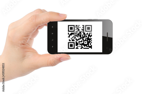 Fotografie, Obraz  Hand holds smart phone with QR code on white background .
