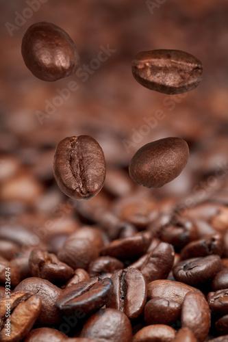 Fototapeta four falling beans and roasted coffee obraz na płótnie