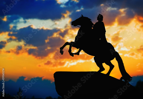 Statue of Peter Great, silhouetted against the sunset. St. Peter Canvas-taulu