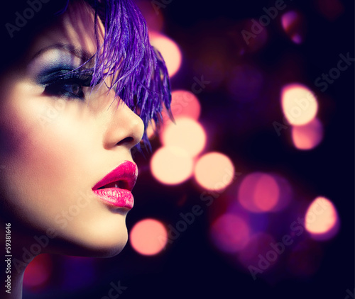 Fashion Model Girl over Glowing Bokeh Background