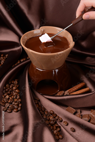 Fototapety, obrazy: Chocolate fondue with marshmallow candies, on brown background