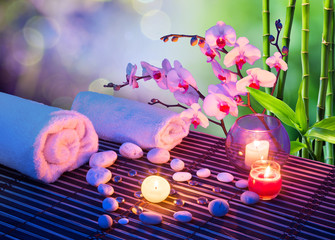 Panel Szklanyheart of stones massage with candles, orchids, towels and bamboo