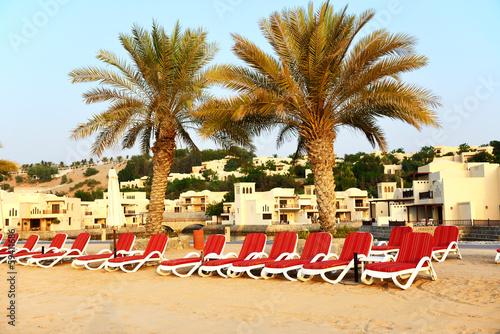 Photo  Beach of the luxury hotel during sunset, Ras Al Khaima, UAE