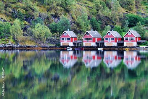 Fototapeta Scenic View of lake and fishing huts in Flam, Norway