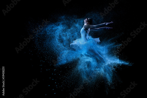 Canvas Young beautiful dancer jumping into blue powder cloud