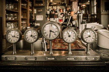 FototapetaVintage clocks on a bar counter in a pub