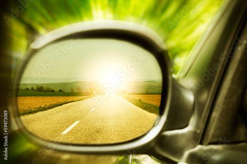 fototapeta na szkło Zachód słońca na samotnej drodze krajowej