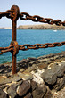 rusty chain water boat and sr in lanzarote spain