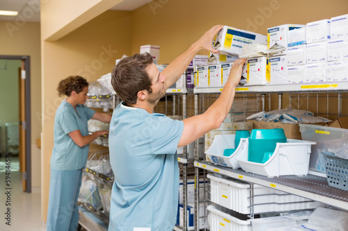 Photo  Nurses Arranging Stock In Storage Room