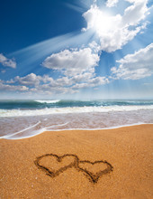 Hearts Drawn On The Sand Of A Beach