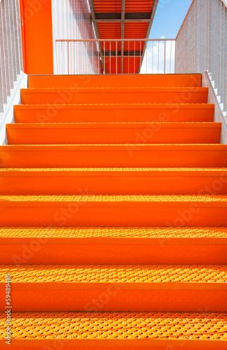 Detail of orange steel stairway Canvas Print