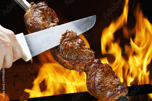Spoed Foto op Canvas Grill / Barbecue Picanha, traditional Brazilian barbecue.