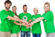 Leinwanddruck Bild - People in recycling symbol t-shirts with hands together