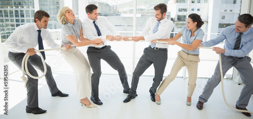 Fotografie, Obraz  Business people playing tug of war in office