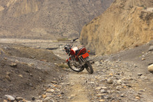 Red Kawasaki Motorcycle On A Mountain Road In The Himalayas