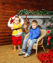Brothers Near Christmas Tree