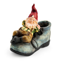 Gnome Sitting On A Boot Isolated With Clipping Path