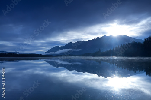 Printed kitchen splashbacks Reflection sunshine over mountains and alpine lake