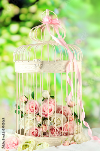 Fotografie, Obraz  Beautiful decorative cage with beautiful flowers,