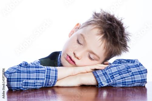 Valokuva  Sleeping boy on the table