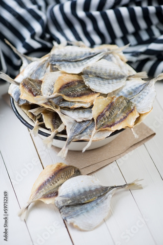 Fotografija Fisherman catch: bowl full of dried scad, vertical shot