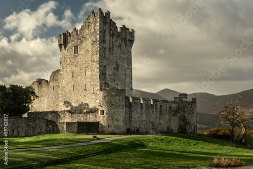 Poster Landscapes Irish castle in dramatic light. Ross castle in Killarney National Park.