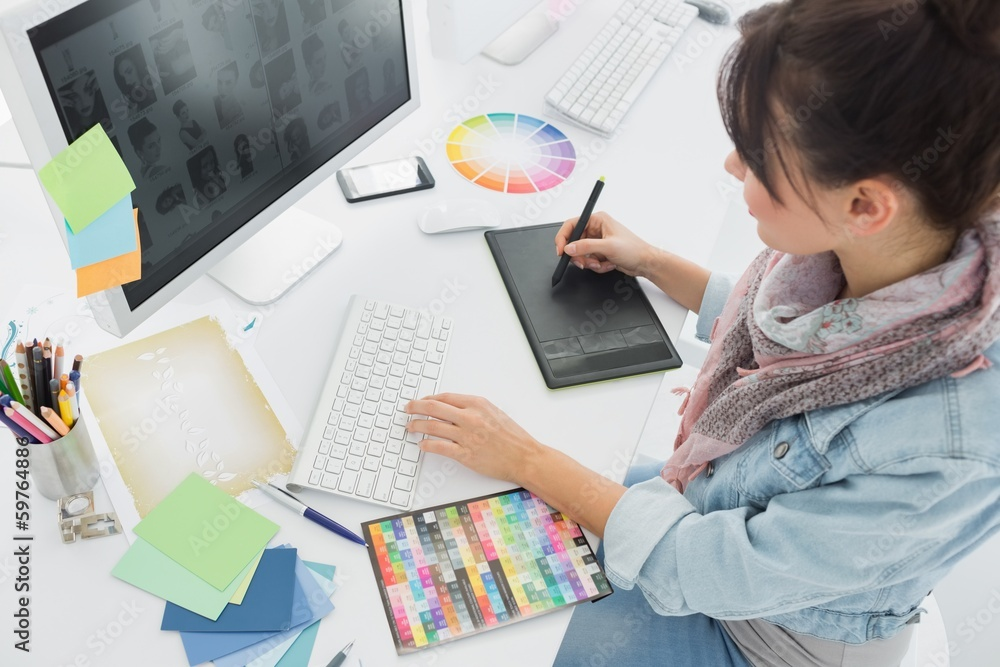 Fototapeta Artist drawing something on graphic tablet at office