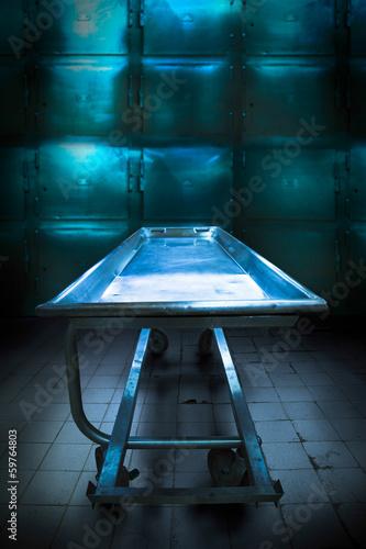 Morgue tray on a grungy morgue Canvas Print