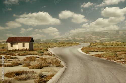 Photo  Lonely House On The Road