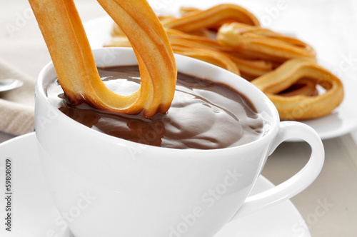 Printed kitchen splashbacks Chocolate churros con chocolate, a typical Spanish sweet snack