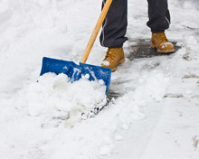 Clearing Snow With Shovel Afte...