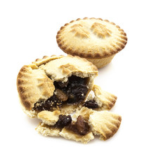 Mince Pie Broken In Half Showing Mince On White Background