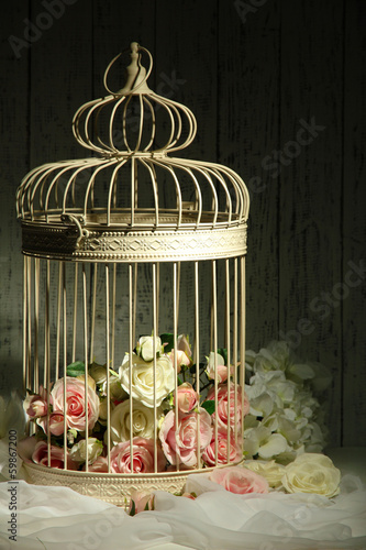 Fotografie, Obraz  Beautiful decorative cage with beautiful flowers