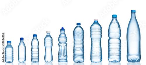 Fényképezés  Many water bottles isolated on white