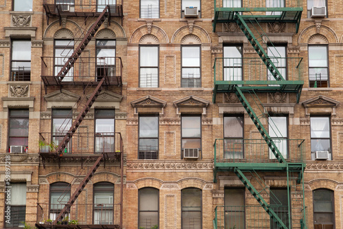 Poster de jardin Con. Antique The typical fire stairs on old house in New York
