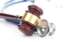 Brown Gavel And A Medical Stet...