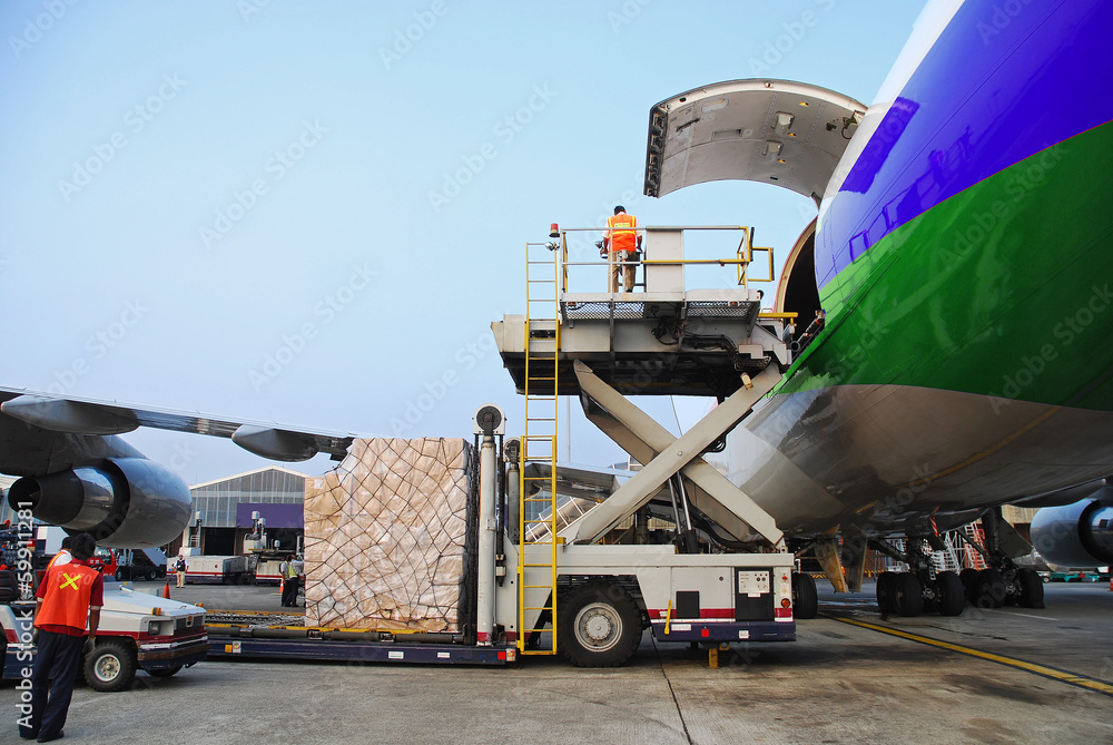 Fototapety, obrazy: loading goods to cargo plane at airport